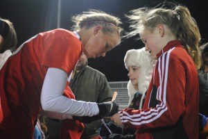 Washington Spirit forward Stephanie Ochs, 22, signs autographs for fans after the game at Ludwig Field.